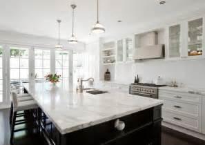 white kitchen black island calcutta marble countertop transitional kitchen porchlight interiors