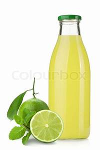 Lime juice bottle, ripe limes and mint | Stock Photo ...