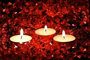 Lighted candles on a red background   Stock Photo   Colourbox