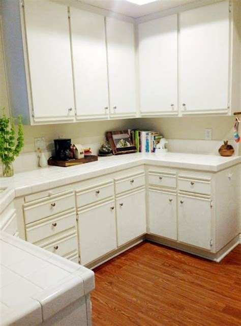 easy kitchen cabinet makeover paint laminate painting