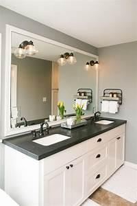 the master bathroom has black granite countertops with With white bathroom vanity with black countertop