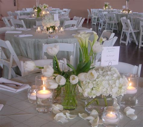 extensive white decorating table for table decor with red roses and white tulips centerpiece