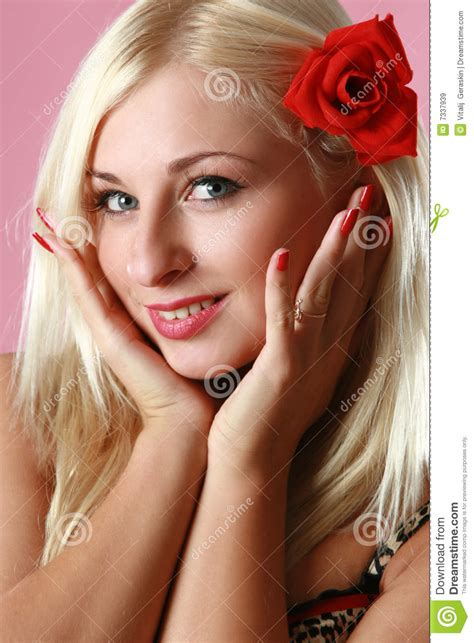 Beautiful Sexy Blonde With Red Flower In Hair Royalty Free