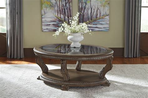 A combination of décor and utility CHARMOND TRADITIONAL OVAL PIECE COFFEE TABLE SET SIGNATURE DESIGN BY ASHLEY PRODUCT   furniture ...