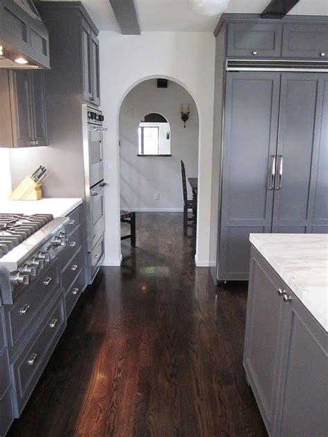 hardwood flooring in kitchen problems grey kitchen arched opening marble counters white walls 7009