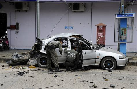 car bomb thai car ripped apart by explosion as bomb expert inspects autoblog