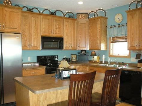 Blue Kitchen Walls With Brown Cabinets by Light Turquoise Kitchen Walls With Brown Cabinets Home