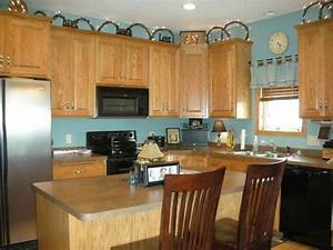 light turquoise kitchen walls with brown cabinets home With kitchen cabinets lowes with brown and turquoise wall art