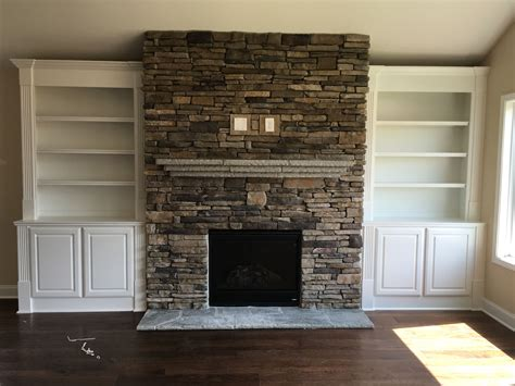 stacked for fireplace stacked stone fireplace with a flagstone mantle and custom built in bookcases www windsonglife