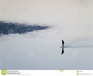 Man Walking Alone In A Desert Beach Stock Photos - Image ...