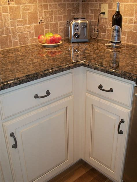 brown cabinets with white countertops antique white cabinet black oil rubbed bronze hardware