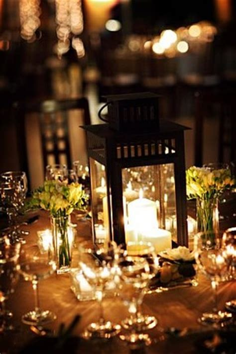 centerpieces with lanterns candle lantern centerpieces but i don t know how tall they should be weddingbee