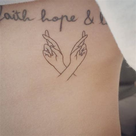crossed fingers tattoo   ribs