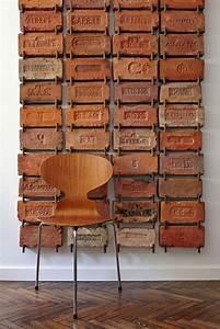 Antique bricks used as wall art very cool idea