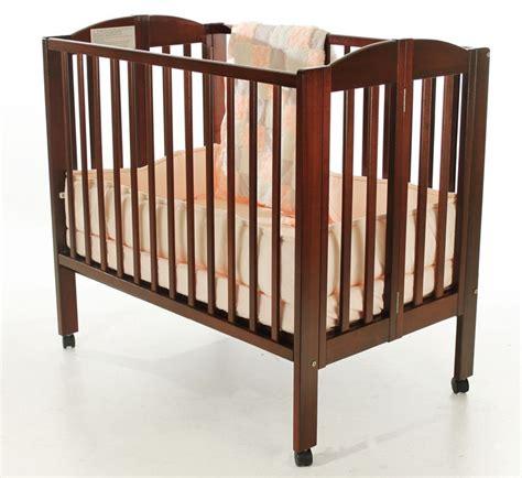 on me portable crib on me 2 in 1 portable folding crib cherry baby