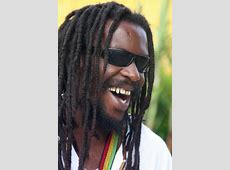 Cool Jamaican guy posing for a picture Jamaican people