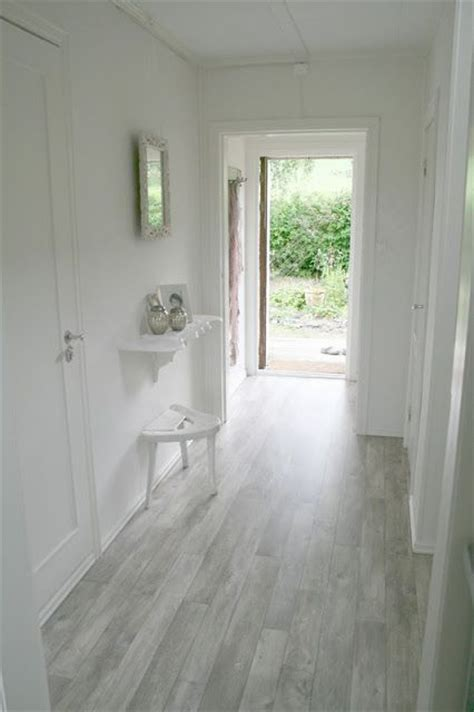 gray wood floors grey floor in the hallway definitely gives a light feeling to the room want this color in the