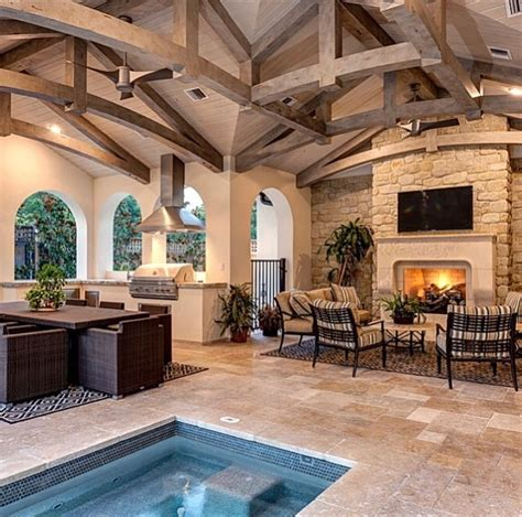 covered patio  fireplace outdoor kitchen  inground