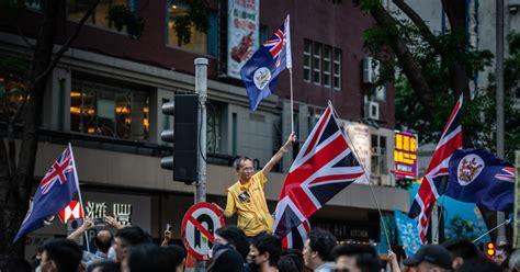 Hong Kong protesters waving UK's Union Jack flag ...