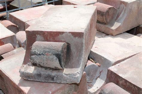 Corbel Course by Reclaimed Orange Corbel Header Bricks Cylinder