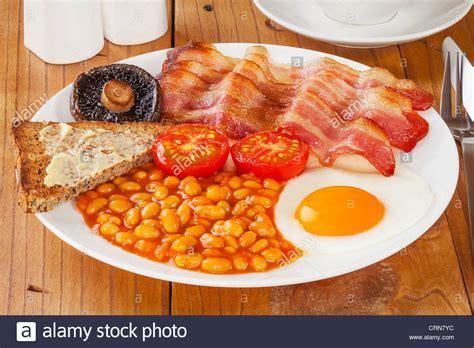 Full English breakfast on an old pine kitchen table Stock