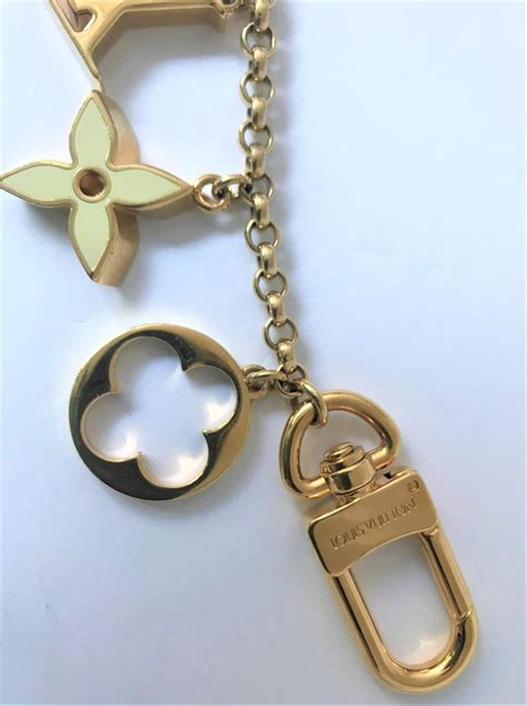 louis vuitton gold pochette fleur de monogram lv bag charm chain key ring luxury handbag