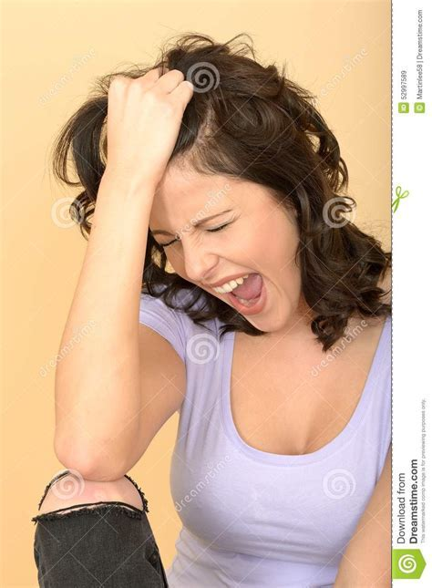 Angry Frustrated Young Woman Pulling Hair And Screaming