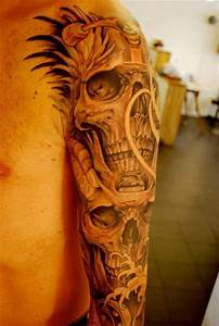 Awesome men skull tattoo on shoulder - TattooMagz