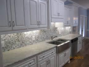 image result for cream cabinets grey glass backsplash grey