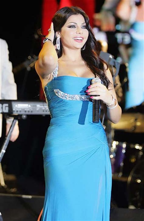 haifa wahbi during a concert wearing a glam baby blue dress singing on stage