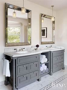 in the master bathroom rosenfeld hung a pair of With choosing custom bathroom cabinets over toilet