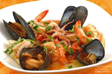 seafood medley  tomato butter sauce  soft polenta