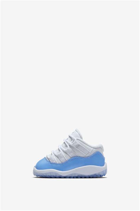 Air Jordan 11 Retro Low White And University Blue
