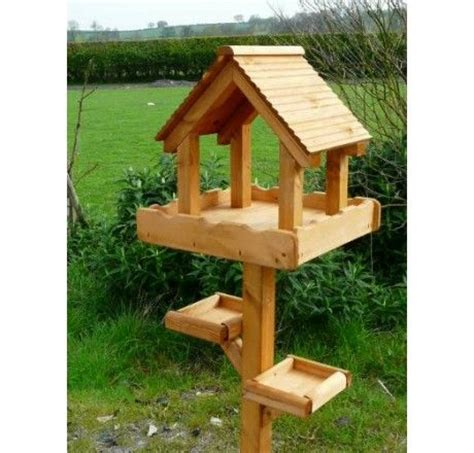 the 25 best ideas about wooden bird feeders on pinterest