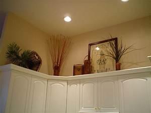 Above kitchen cabinet decorating ideas best home for Ideas for decorating above kitchen cabinets