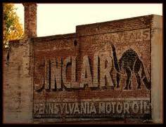 A vintage brick wall advertisement painted on the side of