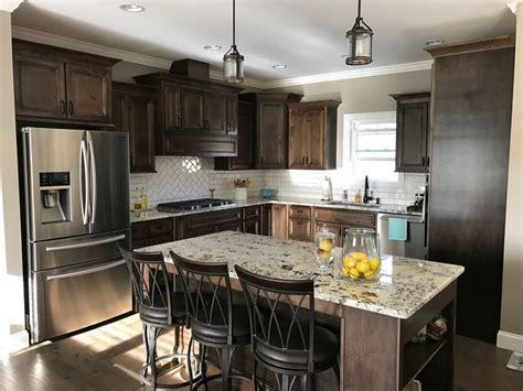 dark walnut stained cabinets alaska white granite white