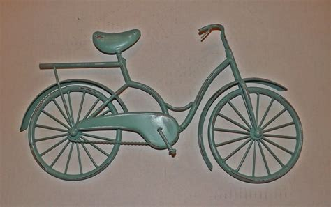 Hanging this old bike caulk board wall décor can be a unique way to give the walls of your country home an elegant and nostalgic feel of yesteryear. Bicycle Wall Art / Wall Decor / Metal Bicycle / by Theshabbyshak