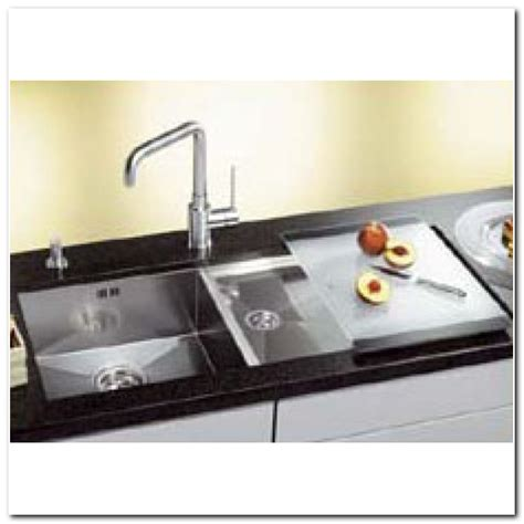 kitchen faucets uk formica solid surface undermount sinks sink and faucet