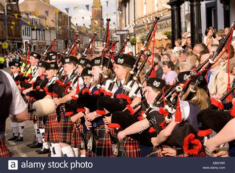 Pipe Band Young Kids Playing Bagpipes On Annan High Street