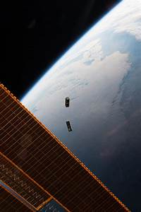 NASA image: CubeSats deployed from the international space ...