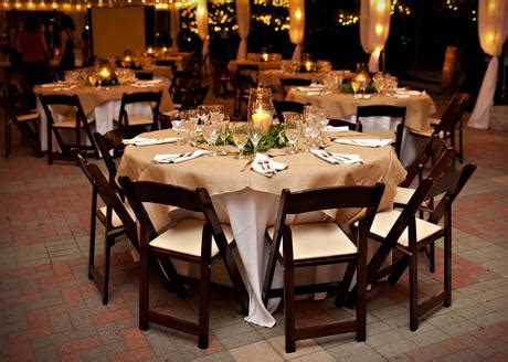 how much to rent tables and chairs brown fruitwood chair