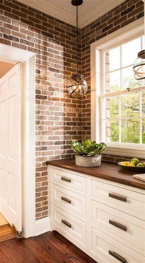 decorating kitchen cabinets best 25 brick wall kitchen ideas on exposed 3114