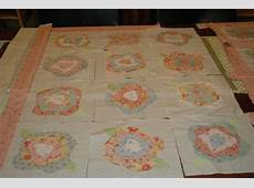 Sashing or no sashing on my French Rose Quilt for grand baby