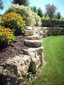 Natural limestone boulder retaining wall. Boulders are ...