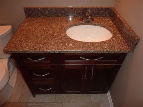 Kitchen cabinets and 2 bathrooms with quartz countertops