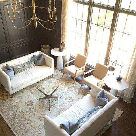 story black paneled living room  white tufted
