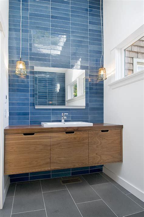 horizontal tiles bathroom modern  wood vanity nickel sink faucets