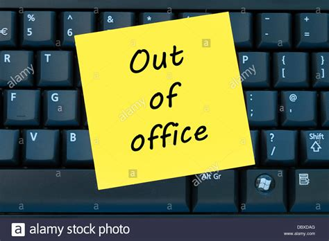 post it bureau out of office post it sticky yellow note stock photo