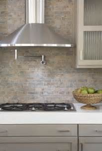 kitchens pot filler tumbled linear tiles backsplash taupe gray kitchen cabinets white